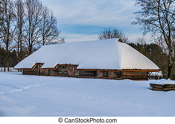 Traditional Wooden Barn or Hut in the Winter Day