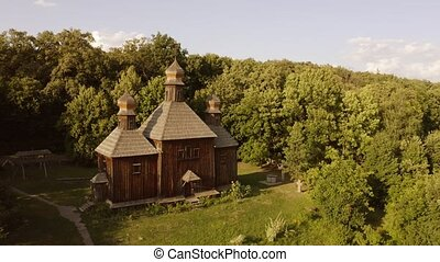 Traditional wooden church in a forest.