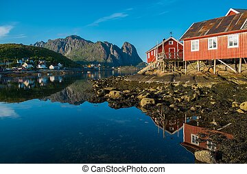 Traditional wooden houses against  in Reine village, Norway