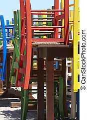 Traditional wooden multicolored chairs in Crete. Greece