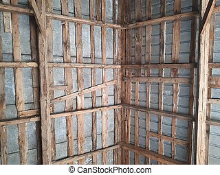 traditional wooden roof framework seen from below