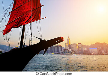 Traditional wooden sailboat / tourist junk sailing in ...