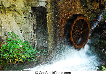traditional wooden water wheel in motion