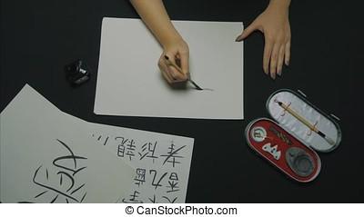 Traditional writing brush. Chinese writing brush. Girl is...