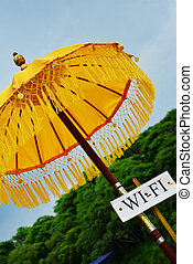 Traditional yellow Hindu umbrella