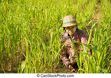 Traditional young Asian female farmer