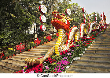 Traditionally decorated ladder in the Chinese park - a red dragon and bright flowers