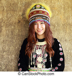 Traditionally dressed Mhong hill tribe woman in the wooden cottage