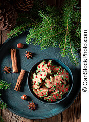 Traditionally gingerbread cookies for Christmas with pinecone