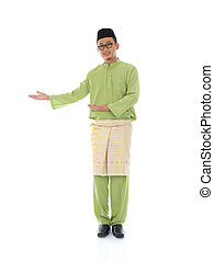 Traditonal Malay man with welcome gesture during ramadan isolated white background