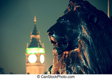 Trafalgar Square lion statue and Big Ben in London