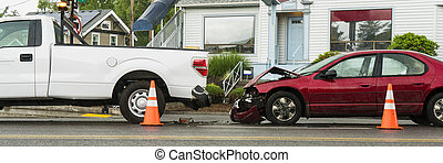 Traffic accident between passenger car and a pickup truck