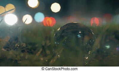 Traffic and glass orb at the roadside - Close-up shot of...