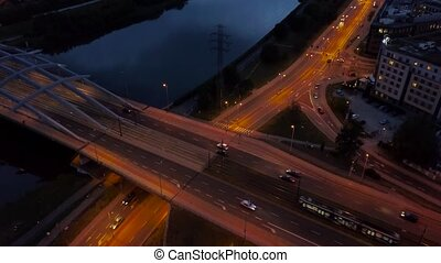 Traffic at night on the highway in Krakow, a bridge across the Vistula River