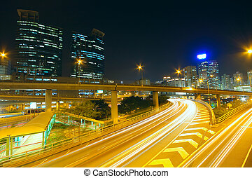 Traffic at night with traces of lights left by the cars on a highway