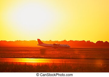 Traffic at the airport - Airport at the sunset (silhouette)....