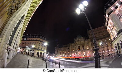 Traffic at the street near Opera National de Paris in the nighttime. Grand Opera Paris, France timelapse hyperlapse
