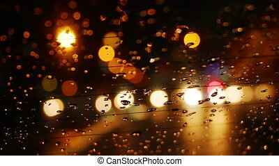 traffic bokeh lights in rainy night city