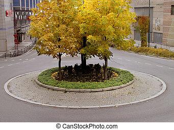 Traffic Circle - A traffic circle in autumn, in europe,...