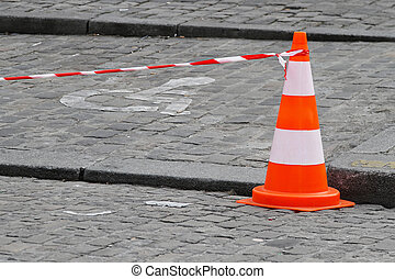 Traffic cone - Traffic safety cone with line at street