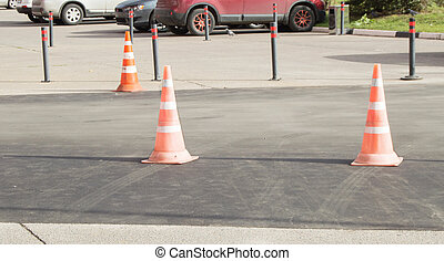 Traffic cones in the Parking lot, used warning sign on the road, summer, outdoor