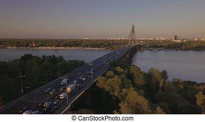 Traffic congestion during rush hour, traffic jam, traffic jam on the bridge during sunset Kiev Ukraine September 2020