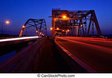 Traffic Crossing Bridges at Night