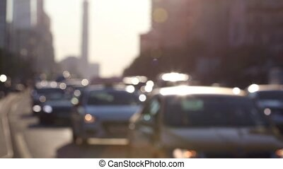 Traffic during rush hour on the sunlit streets of the city. Real time. Blur focus