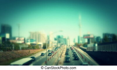 Traffic entering a city. Swing tilt miniature style. -...