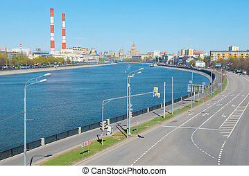 Traffic flow freely on Berezhkovskaya Embankment of Moscow River. View of the center of Moscow and the building of the Ministry of Foreign Affairs of Russia