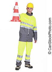 Traffic guard holding a pylon