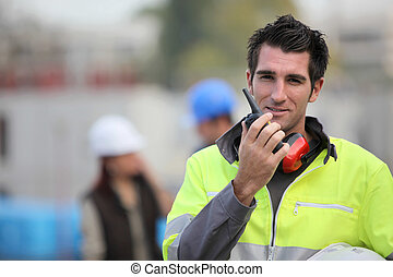 Traffic guard speaking into his walkie talkie
