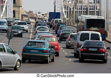 Heavy traffic passing through a bridge