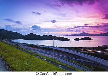 Traffic highway in Hong Kong at sunset
