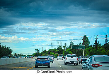 Traffic in a freeway on a cloudy day in California, USA