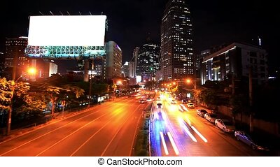 Traffic in Bangkok, Thailand. Advertising board near the road. Timelapse speed up at night. HD. 1920x1080