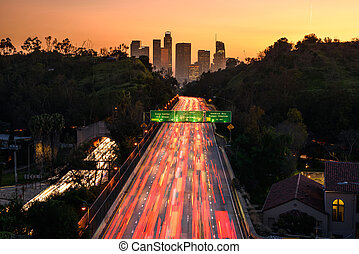 Traffic in downtown Los Angeles, California at sunset