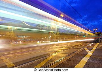 Traffic in Hong Kong at night. Light rail.