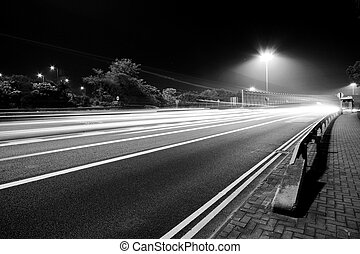 Traffic in modern city in black and white tone