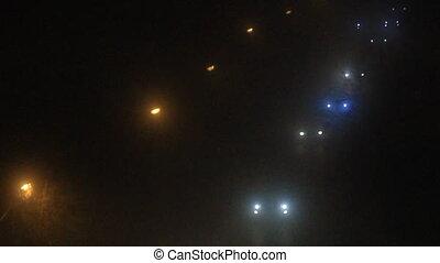Traffic in night fog
