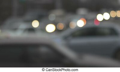 Traffic in the city. Dusk Defocused