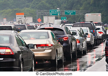A typical scene during rush hour. A traffic jam with rows of cars waiting to get off the next exit.