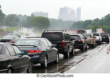 Traffic Jam Congestion - A busy congested highway during...