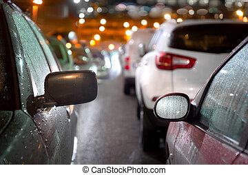 Traffic jam in evening - Traffic jam on busy street in rainy...