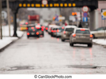 Traffic jam in the city, winter, defocused cars