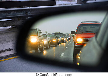 Feflection of a traffic jam in a sideview mirror