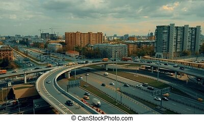 Traffic jam on city highway interchange, Moscow. 4K aerial...