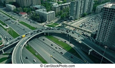 Traffic jam on city road junction in Moscow, Russia. 4K aerial video