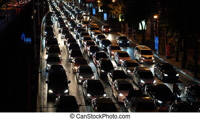Traffic jam on the busy street during rush hour at night time