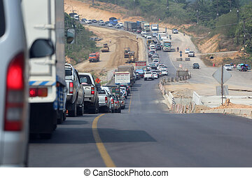 traffic jam on the road because work highway construction. -...